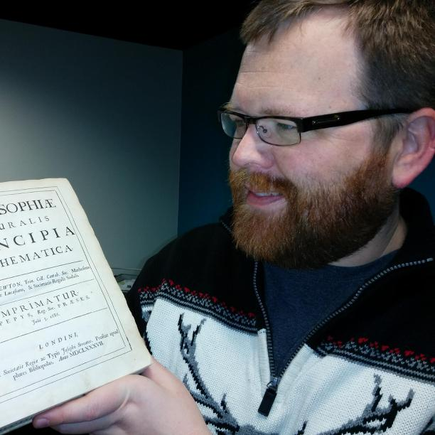 Picture of Logan with Principia Mathematica 1st ed.